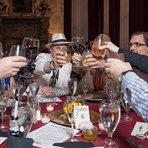 Dallas Murder Mystery guests raise glasses