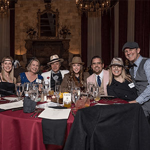 Dallas Murder Mystery party guests at the table